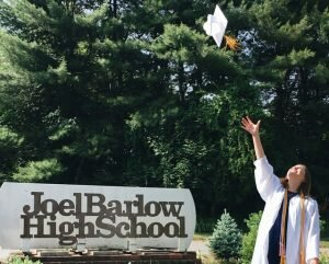 2018 Joel Barlow graduate Mackenzie Wenzel tosses her cap into the air.