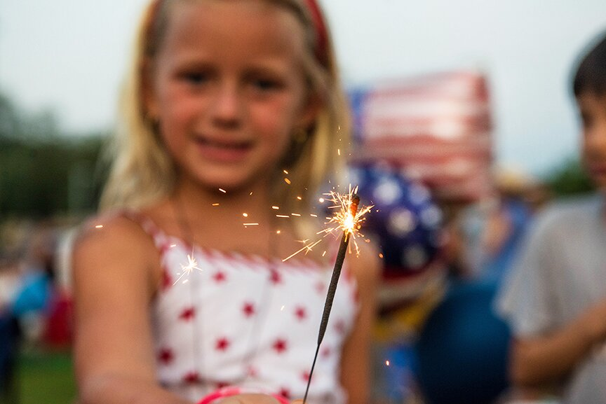 6-year-old Avery Mihelic holds a sparkler at the July 4 fireworks in Weston. — Bryan Haeffele photo